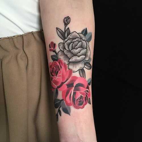 Arm Tattoo drei Rosen